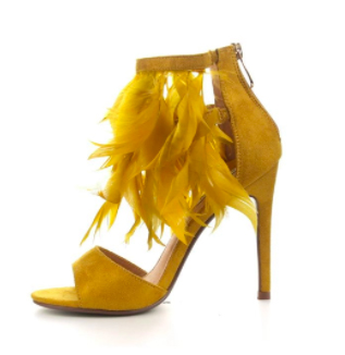 Mustard Feather Heels, Mustard yellow high heels with an open-toe and zipper closure at the back. This classy heel is adorned with matching mustard yellow feathers hanging from the supporting ankle strap.