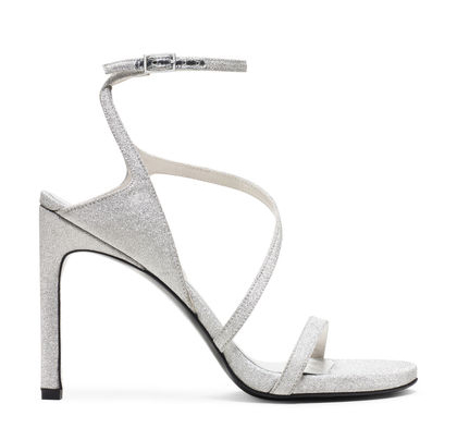Sultry- Sexy single-sole stilettos soar to new heights this season, led by the SULTRY. These must-have sandals are finished with wrap-around straps and are available in a variety of unique materials, including our signature glitter fabric, denim and silk. Wear with everything from a sleek pencil skirt to dark-washed jeans.