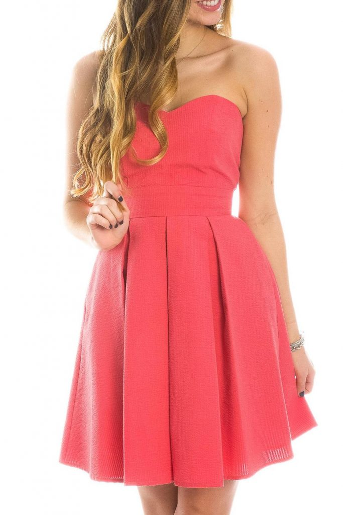 Lauren James - CORBIN SEERSUCKER DRESS -A classic strapless dress with a twist! Now in SOLID SEERSUCKER colors! This dress features a sweetheart neckline, with a self-tie back that you can custom-fit to your body. The pleated skirt and pockets top off this classic look! This is the perfect dress for a lunch date or Easter Sunday, and it's sure to hold a place in your heart (as well as your closet) season after season!