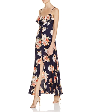 Band of Gypsies Floral Flounce Maxi Dress - Add romance to this season's lineup wearing this flattering, floor-skimming maxi from Band of Gypsies, suspended by adjustable shoulder straps and flaunting a vibrant floral print.