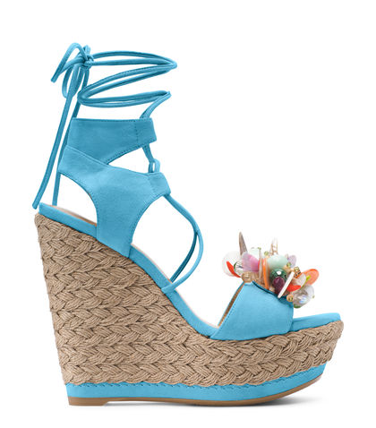 CAKE - Looking fabulous is a cakewalk in this eye-catching essential: These winning wedges are set on a braided jute sole, crafted from sumptuous suede, adorned with a toe strap embellishment and finished with sexy, serpentine laces designed to coil around the calf. Try with relaxed trousers and a ruffled blouse.