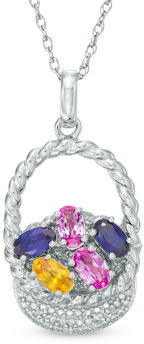 "Oval Lab-Created Multi-Color Sapphire and Diamond Accent Easter Basket Pendant in Sterling Silver - Pretty as a picture, this gemstone fashion pendant is a year-round springtime remembrance. Crafted in sterling silver, this Easter basket is filled with 5.0 x 3.0mm oval-shaped lab-created bright pink, deep blue and sunny yellow sapphire ""eggs"" that catch the eye. Diamond accents and beaded detailing sparkle on the charming basket, completing the design. Polished to a bright shine, this bunny-worthy style suspends along an 18.0-inch rope chain that secures with a spring-ring clasp."