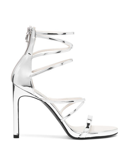 A must-have for every glamazon, this sleek strappy sandal is as sexy as it is luxurious. Wear with tailored evening separates and statement earrings.
