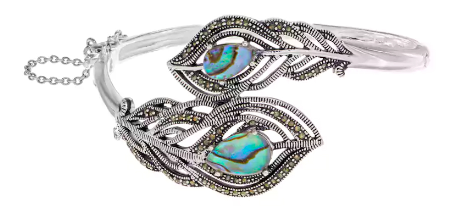 Abalone & Marcasite Silver-Plated Peacock Feather Bangle Bracelet. Featuring an ornate peacock feather design with abalone inlays and marcasite accents, this bracelet offers a uniquely bold look.