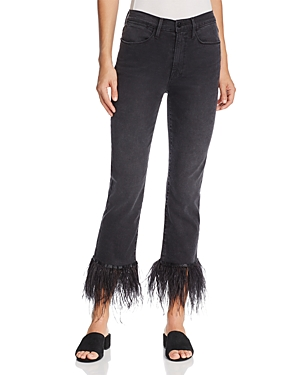 Frame Le High Straight Feather-Cuff Jeans in Ludlow. Glamorous feathers trim the cuffs of these high-waisted, classic straight-leg jeans from Frame-making an unexpected and brilliant juxtaposition against faded black denim.
