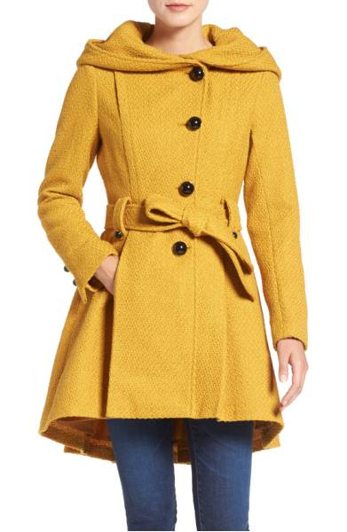 STEVE MADDEN Belted Hooded Skirted Coat. Lush texture enriches a pretty winter coat topped with a generous hood and nipped with a tie belt. CLICK TO PURCHASE.