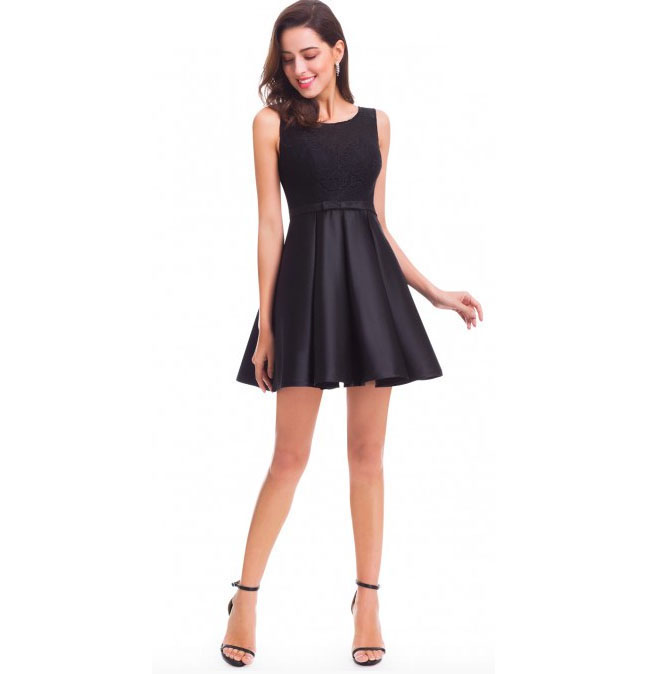 Fit and Flare Little Black Party Dress. This dress is fully lined. A concealed side zipper secures the dress in place. This dress is not stretchy. On most women this dress will be short, reaching mid thigh in length. $54.99 (Regularly $59.99).