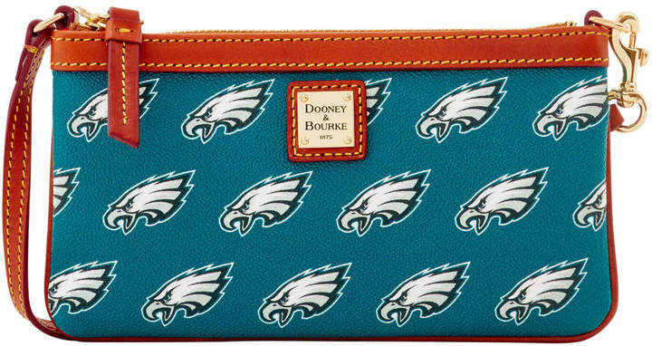 NFL Eagles Large Slim Wristlet. Fly, Eagles, Fly! Rep your team with an officially licensed Philadelphia Eagles bag or accessory. The epitome of understated chic, this wristlet is the perfect all-in-one for your mobile phone and your cash and cards. It features a zip closure and a wrist strap.