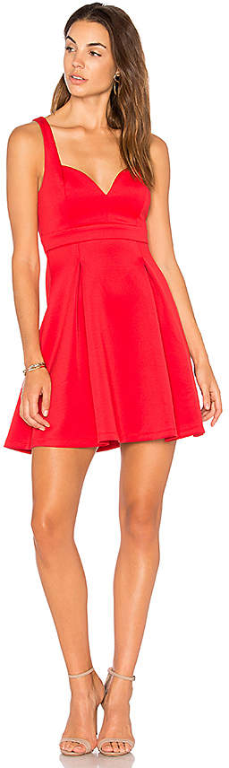 BCBGeneration Babydoll Dress. Dress contains pleated front detail and a back cut-out.