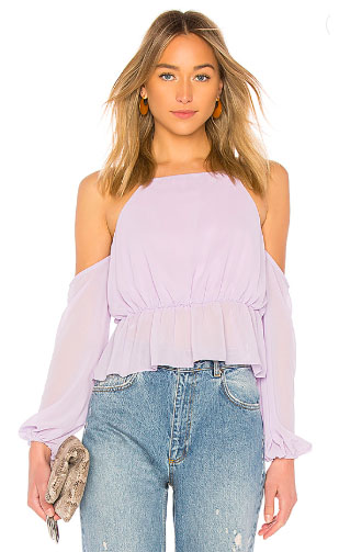 The Bebe Blouse by Lovers + Friends. Tailored to perfection, the Bebe Blouse by Lovers + Friends showcases the right way to do bold shoulders. Spun from light chiffon fabric in flattering pastel lilac, this top is defined by an elastic waist, designed to accentuate. Color Me Happy With Pastels.