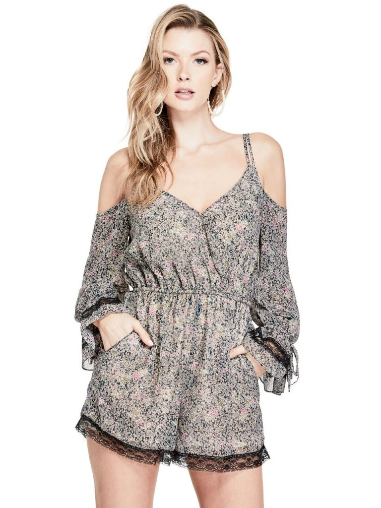 GUESS Women's Beverly Cold-Shoulder Romper. Cold-shoulder romper elevates your daytime look with an allover floral print and lace trim with ruffled sleeves.