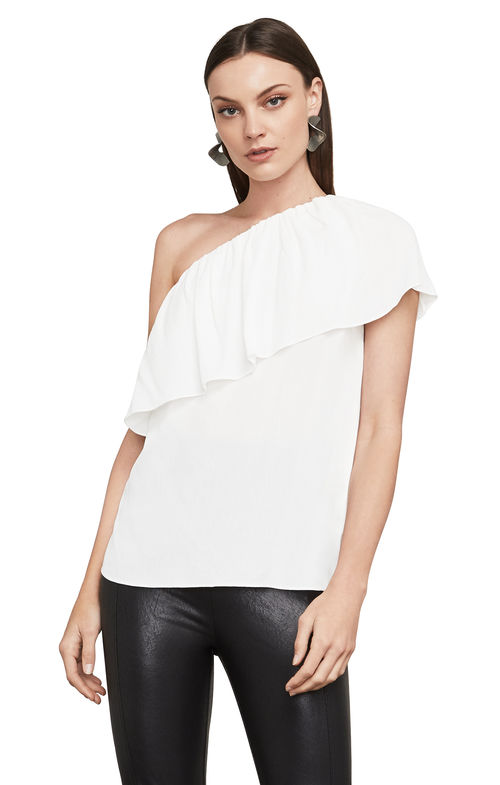BCBG Max Azria Kamila One-Shoulder Top. A carefree, Bohemian spirit of this single-shoulder creation. Its fluid, ruffled neckband and gentle fabric drape evoke a retro-chic style that looks just as great with denim as it does with dressier pieces.