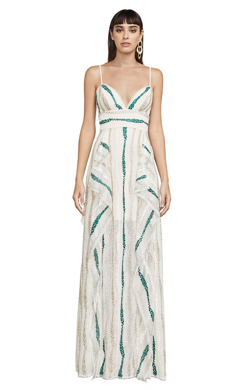 BCBG Liliana Tulle Maxi Dress. Multi-dot embroidery on tulle defines this floor-grazing dress infused with a whisper of metallic that features fluid ruffles and floral lace adorning its fitted bodice and billowy skirt.