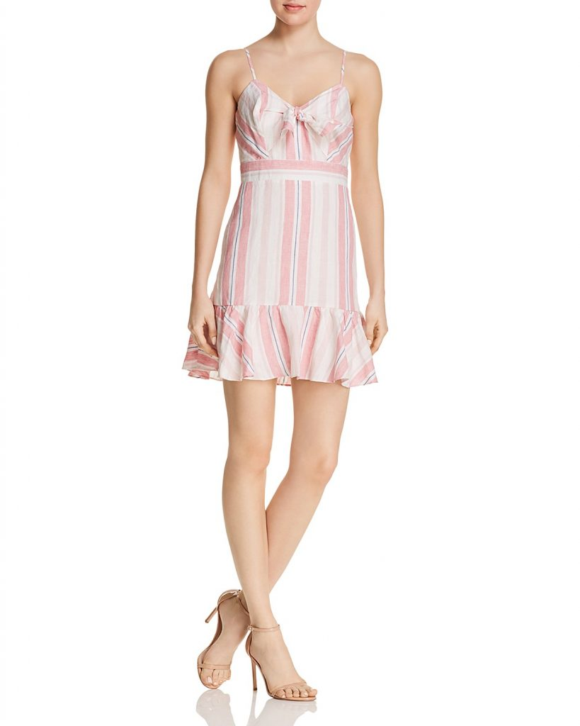 Parker Dany Striped Dress. Dress features V-neck, adjustable shoulder straps, and is sleeveless. Earn Your Fashion Stripes.