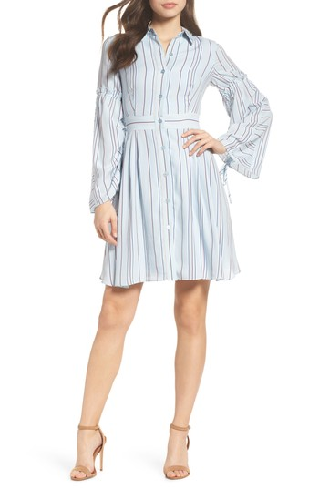 Taylor Dresses Stripe Shirtdress. An updated take on the classic shirtdress, this version in slim variegated stripes is refreshed with billowing sleeves cinched with delicate ruching. Earn Your Fashion Stripes.