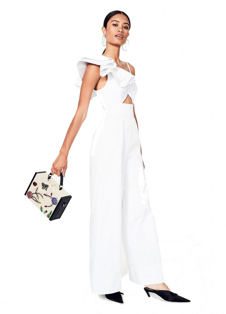 The Los Feliz Jumpsuit by Fame & Partners. Suit up. The Los Feliz jumpsuit is a cotton sateen maxi jumpsuit featuring a structured ruffled shoulder and wide-leg pants. It has an invisible zip closure. It Suits You - White Jumpsuits.
