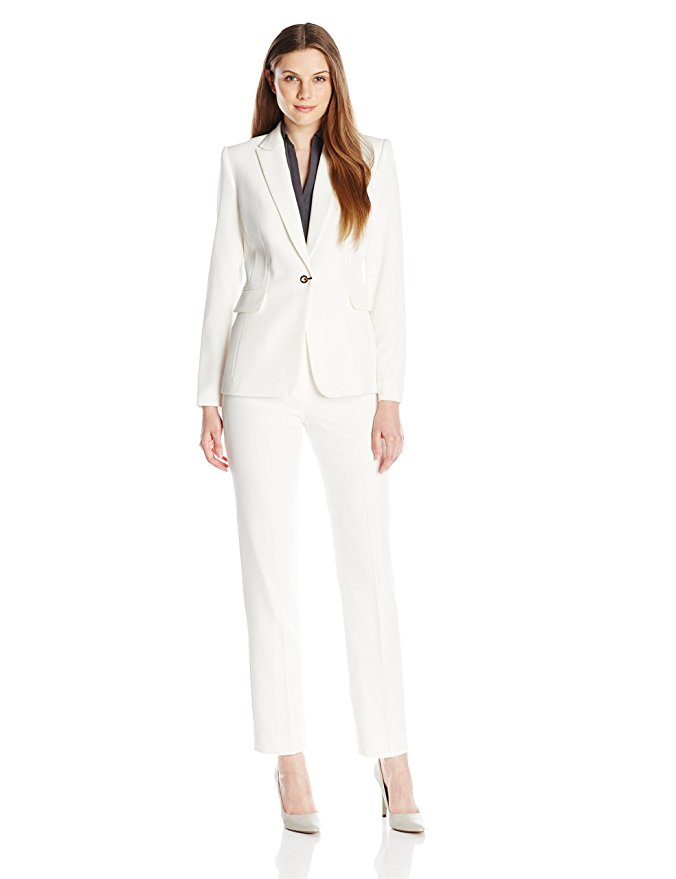 Tahari by Arthur S. Levine Women's Crepe Pant Suit is a two-piece crepe suit with collarless jacket and straight-leg pant. The jacket features hook-and-eye front closure and zippered pockets.