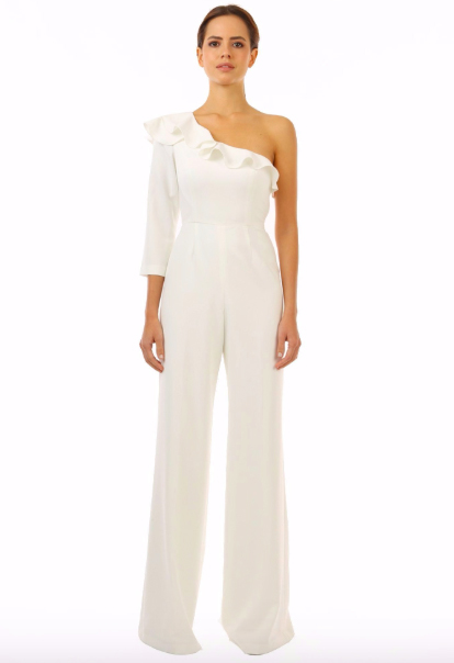 The Jay Godfrey Pogge Jumpsuit is a perfect multi-season jumpsuit - taking you from Spring to Summer in no-time. A ruffle shoulder features our favorite detailing (flounce!) And a long sleeve brings a bit of interest to the top of this otherwise classic shape.