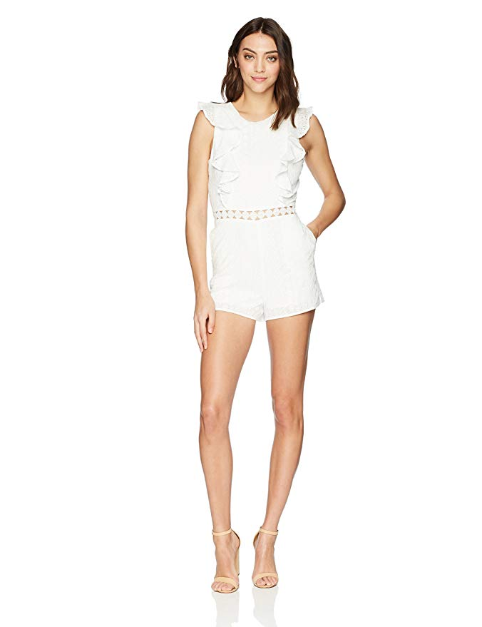 JOA Women's Eyelet Sleeveless Ruffled Romper With Flared Hem. A beautiful cotton, sleeveless romper with zipper closure and ruffle detail.