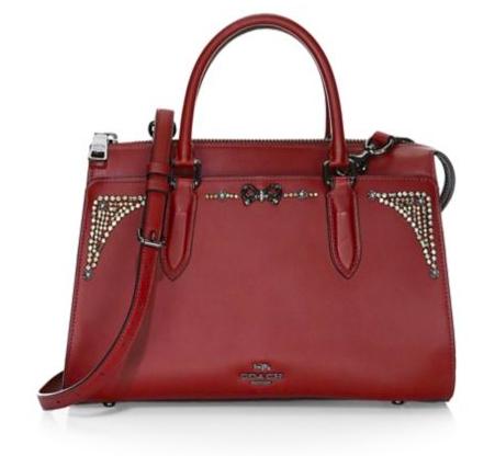 Coach x Selena Gomez Sutton Crystal-Embellished Satchel. This stylish leather satchel boasting feminine crystal embellishments.